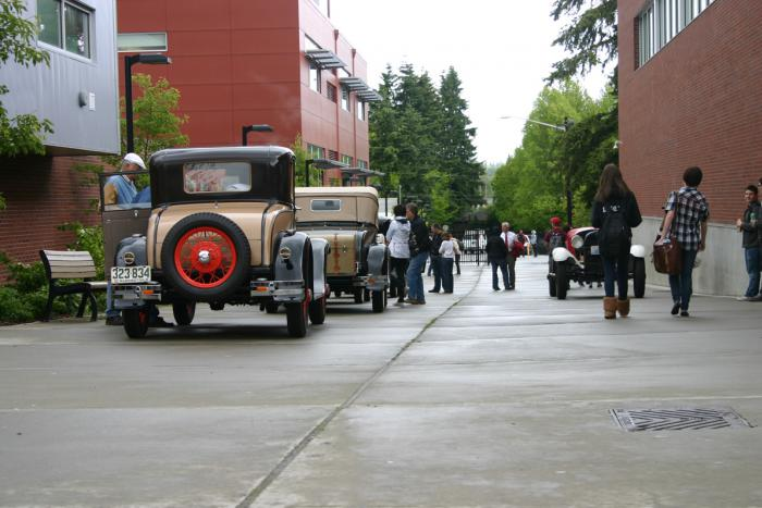 Model A Fords line the SHS promenade.