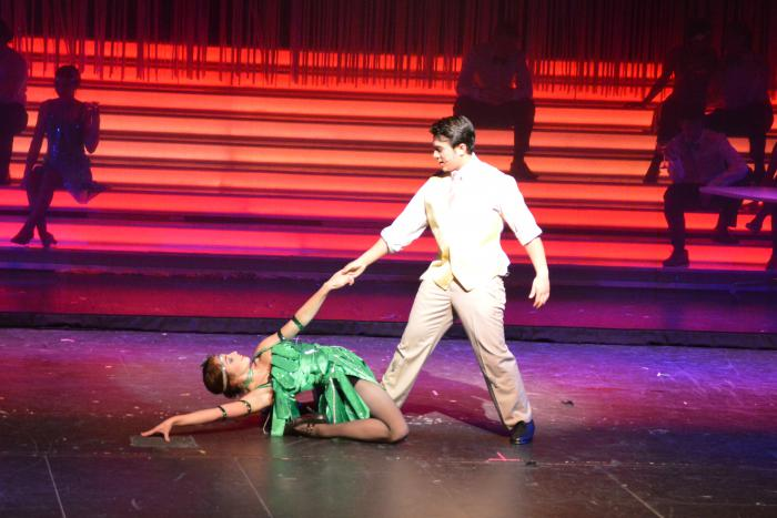 Grace Fenner (Featured dancer) and Braden Sigua (Don Lockwood) dance in Singin' in the Rain.