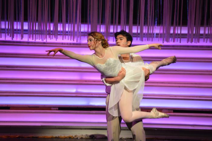 "Junior Grace Fenner (featured dancer) and Braden Sigua (Don Lockwood) dance to ""Broadway Melody"" in SHS's Singin' in the Rain."