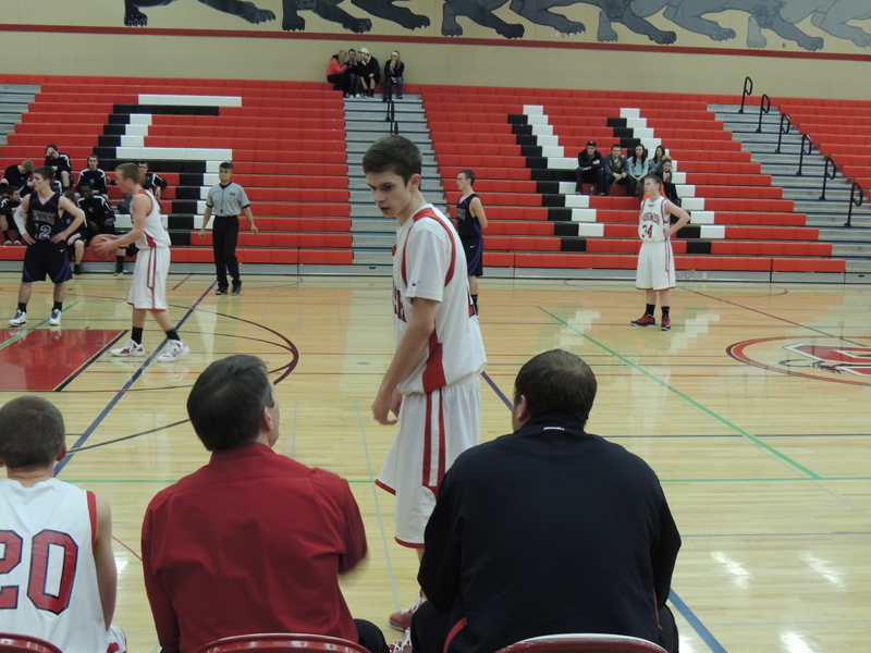 Sophomore Zack Carlson gets instructions from Coach Riedeman during a free throw